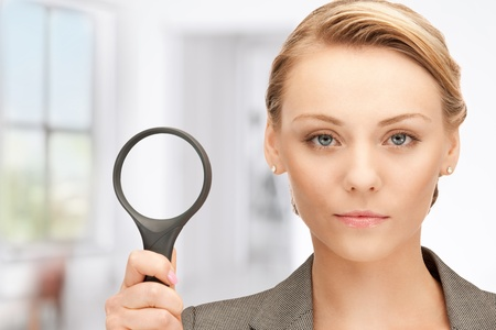 magnified: picture of beautiful woman with magnifying glass