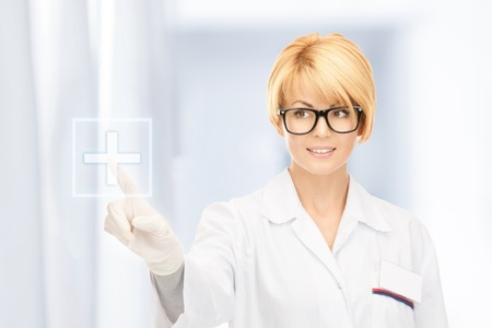 picture of attractive female doctor working with touchscreen Stock Photo - 18320723