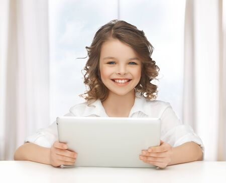 pre teen girl: picture of beautiful girl with tablet pc Stock Photo