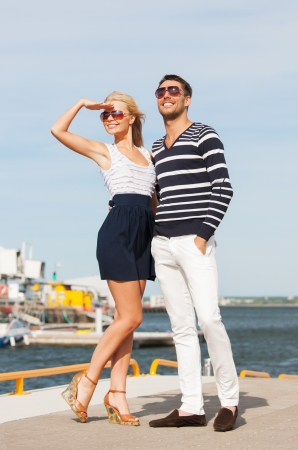 picture of happy young couple in port Stock Photo