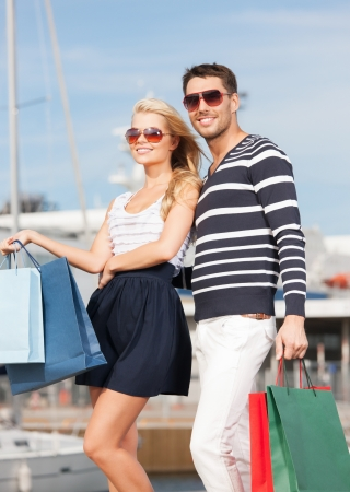 picture of happy young couple with shopping bags Stock Photo - 18320660