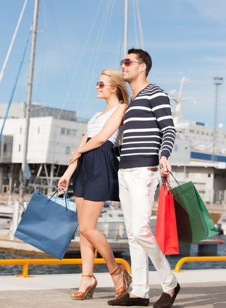 picture of happy young couple with shopping bags photo