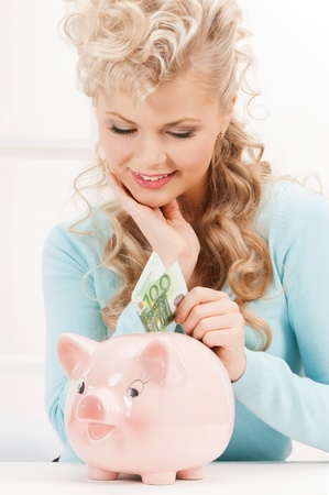 lovely woman with piggy bank and cash money photo