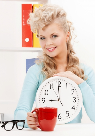 picture of attractive businesswoman with clock and red cup Stock Photo - 18365056