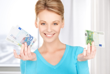 picture of smiling woman with money in hands photo