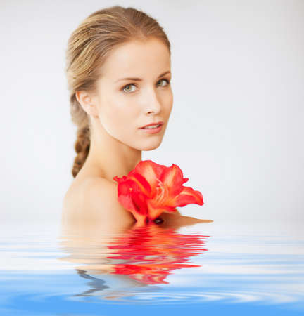 picture of lovely woman with lily flower in water photo