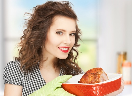 serving: picture of perfect housewife serving dish with meat