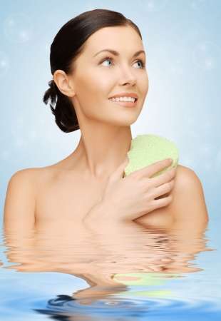 bright picture of beautiful woman with sponge photo