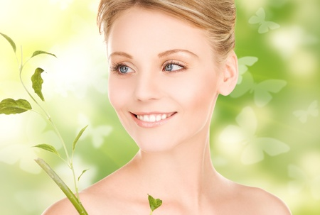 woman with sprout and butterflies over green background Stock Photo - 18364825