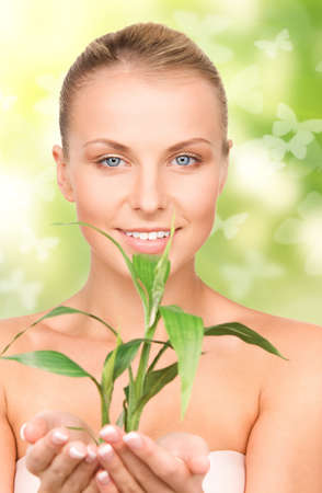 woman with sprout and butterflies over green background Stock Photo - 18365148