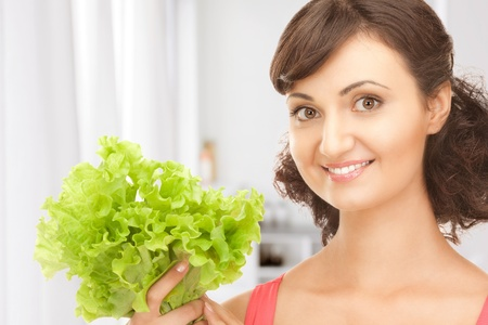picture of happy woman with lettuce in kitchen Stock Photo - 18365350