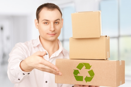 picture of businessman with parcels in office photo