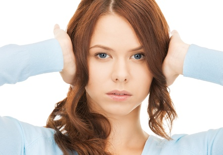 unhappy woman holding her head with hands photo