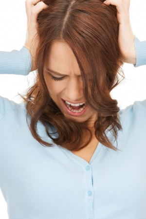 mad woman screaming holding her head with hands Stock Photo - 18365163
