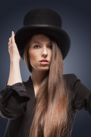 picture of woman in black jacket and top hat photo