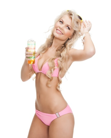 woman in bikini with glass of juice or cocktail photo
