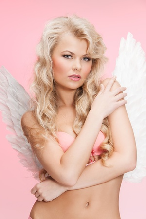 bright picture of angel girl in underwear and wings photo