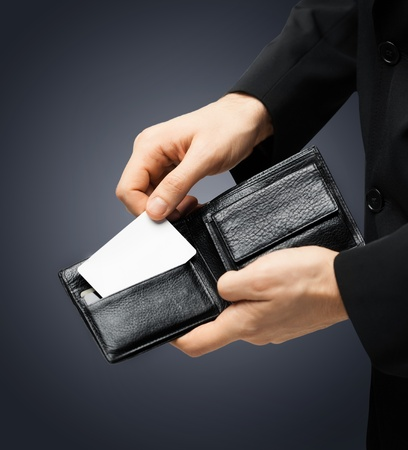 man in suit with wallet and credit card photo