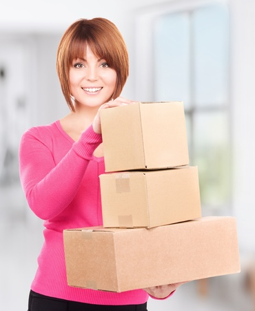picture of businesswoman with parcels in office