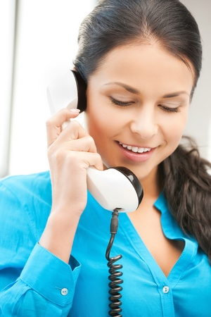 picture of businesswoman with rotary phone calling photo