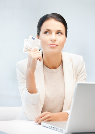save time: picture of smiling businesswoman with cash money Stock Photo