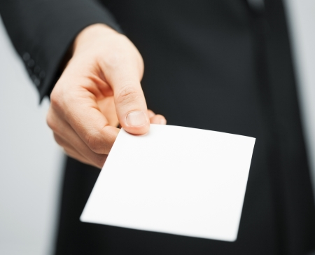picture of man in suit holding credit card photo