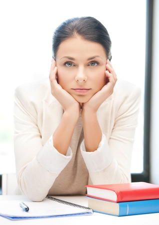 picture of bored and tired woman behid the table Stock Photo - 18409733