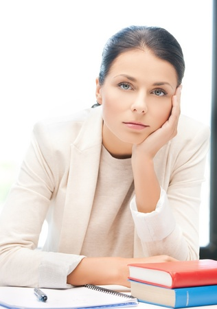 picture of bored and tired woman behid the table Stock Photo - 18409796