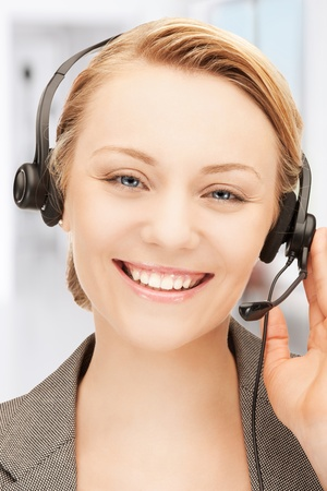 bright picture of friendly female helpline operator Stock Photo - 18423912