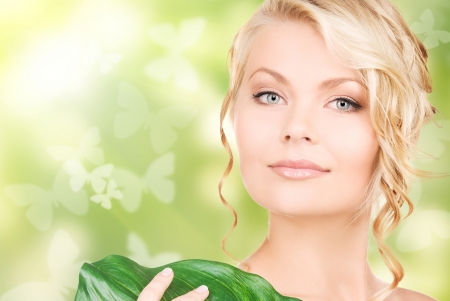 picture of happy woman with green leaf and butterflies photo