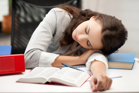 weakness: bored and tired woman sleeping on the table Stock Photo