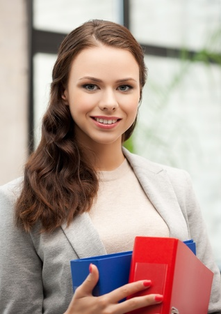 picture of beautiful smiling woman with folder photo