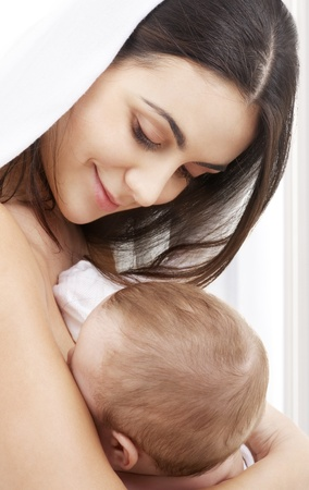 picture of happy mother with baby at home photo