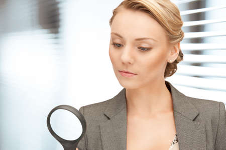 suspicious: picture of beautiful woman with magnifying glass