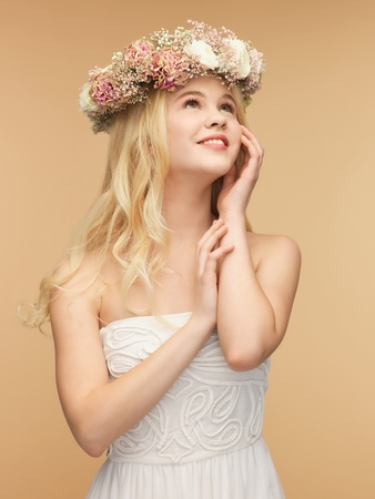 picture of young woman wearing wreath of flowers Stock Photo