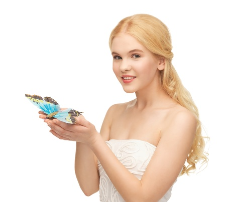 picture of beautiful woman with butterfly in hand Stock Photo - 18523040