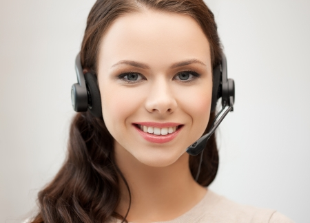 friendly female helpline operator with headphones photo