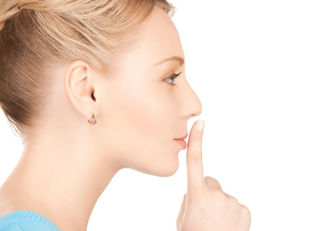 picture of mysterious woman with finger on her lips Stock Photo