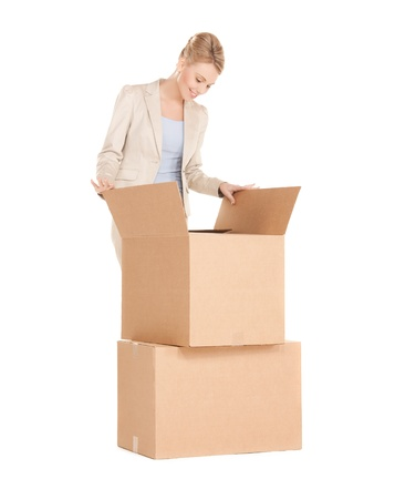 picture of attractive businesswoman unpacking big boxes photo