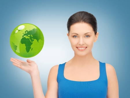 picture of woman holding green globe on her hand Stock Photo - 18530594