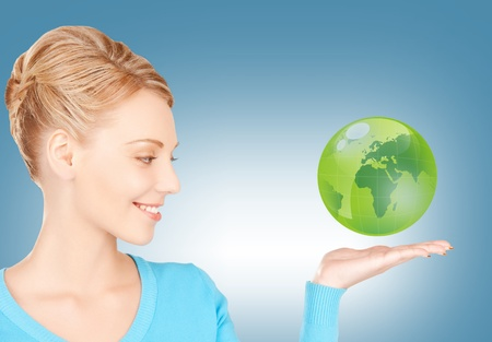 picture of woman holding green globe on her hand Stock Photo - 18530282