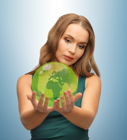 picture of woman holding green globe on her hands Stock Photo - 18530550