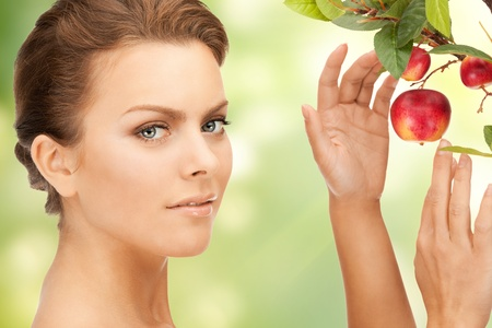 picture of lovely woman with apple twig photo