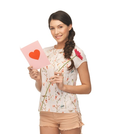 picture of young woman holding flower and  postcard  Stock Photo - 18530151