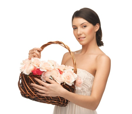 picture of young woman with basket full of flowers  photo