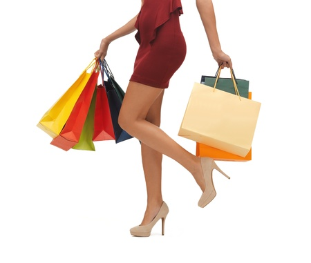 picture of woman s long legs with shopping bags  photo