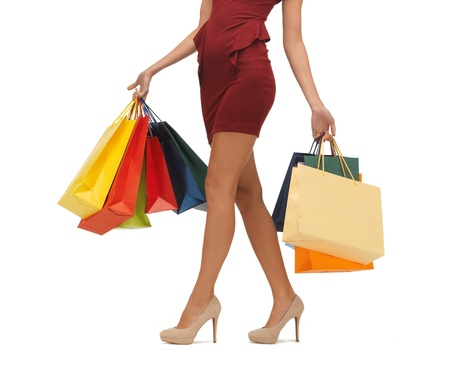 shopaholics: picture of woman s long legs with shopping bags
