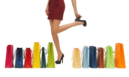 picture of woman s long legs with shopping bags