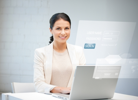 picture of happy woman with laptop computer and virtual screen