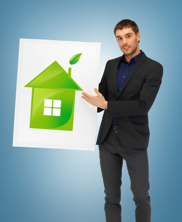 handsome man with illustration of green eco house Stock Illustration - 18655153